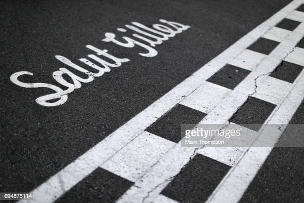 Salut Gilles marking on the track for the circuits namesake Gilles Villeneuve during the Canadian Formula One Grand Prix at Circuit Gilles Villeneuve...