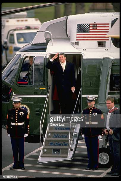 Saluting Pres Reagan pausing before boarding Marine One helicopter as he Nancy leave fr WH after 8 yrs in office