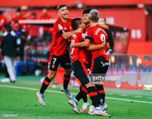Salva Sevilla of RCD Mallorca celebrates with his team mates after scoring his team's first goalduring the Liga match between RCD Mallorca and CD...