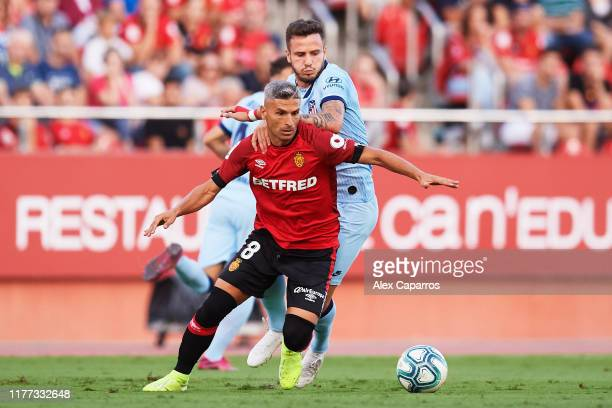 Salva Sevilla of RCD Mallorca fights for the ball with Saul Niguez of Atletico de Madrid during the La Liga match between RCD Mallorca and Club...