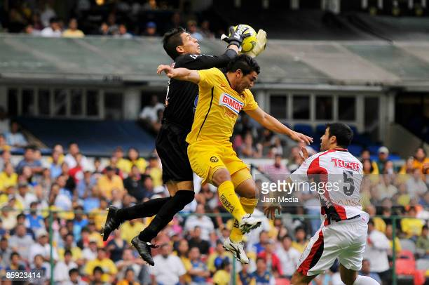 Salvador Cabanas of America vies for the ball with Cirilo Saucedo and Javier Hernan of Indios during their match in the 2009 Clausura tournament the...