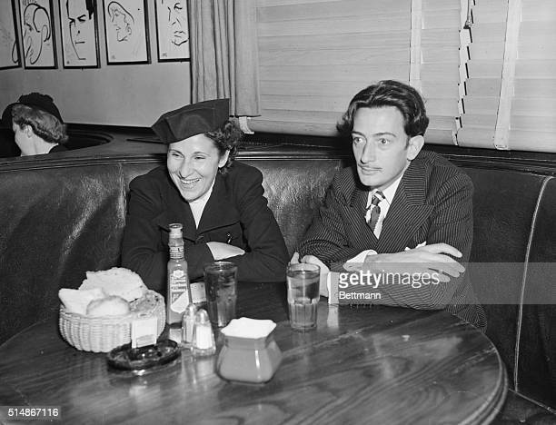Salvador Dali and lifelong love Gala at Hollywood's Brown Derby restaurant in February 1937 Gala was married to poet Paul Eluard when this photograph...