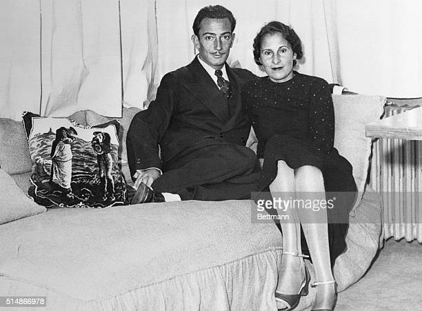 Salvador Dali and lifelong love Gala in Dali's Paris studio in 1934. Gala was married to poet Paul Eluard when this photograph was taken. After...