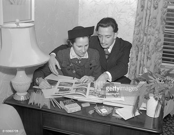 Salvador Dali High Priest of Surrealism in Art is shown with his wife Gala in their suite at the Beverly Hills Hotel shortly after their arrival Mr...