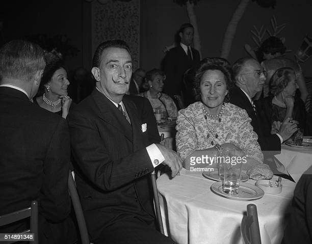 Salvador Dali is shown with his wife at the El Morocco nightclub in New York City