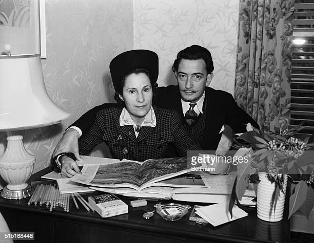 Salvador Dali noted Spanish Surrealist painter accompanied by Mrs Gala Dali are shown here after their arrival at the Beverly Hills Hotel where the...