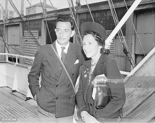 Salvador Dali the noted Surrealist artist and his wife Gala are shown arriving in New York City on August 17th on the American export liner Excambion...