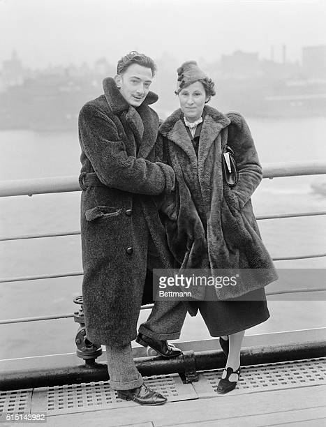 Salvador Dali the well known Spanish Surrealist painter and Mrs Gala Dali are snapped here aboard the S S Normandie upon arrival in New York City on...