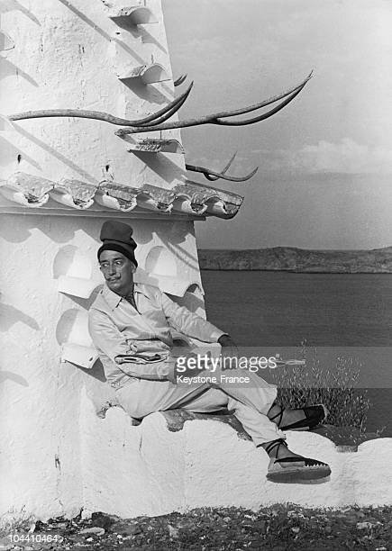 Salvador DALI wearing a typical Catalan hat posing in his garden in Cadaques Catalonia on August 13 1961