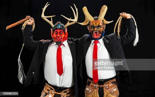 Salvador Garcia and Magdaleno Gracida Gil from San Sebastian Tecomaxtlahuaca rehearse the Dance of the Devils for the Guelaguetza traditional...