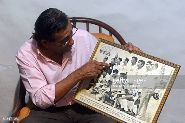 Salvador Mariona, former Salvadoran footballer shows a picture of the national team during the World Cup Mexico 1970 during an interview with AFP in...