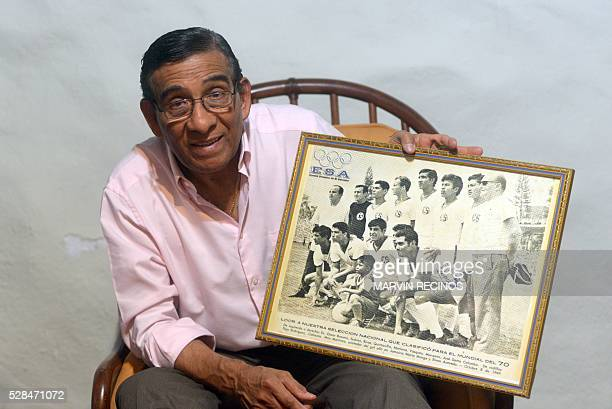 Salvador Mariona former Salvadoran footballer shows a picture of the national team during the World Cup Mexico 1970 during an interview with AFP in...