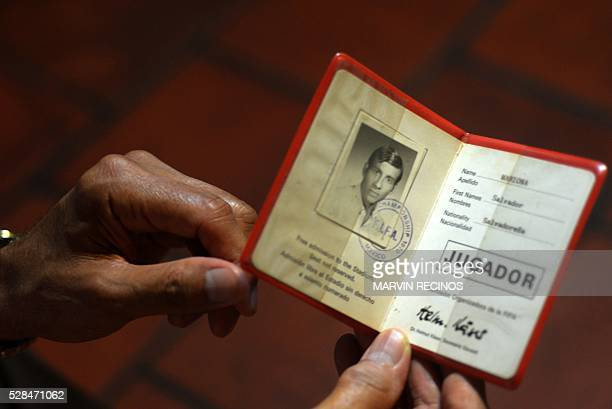 Salvador Mariona, former Salvadoran footballer shows the participation card as a player for the World Cup Mexico 1970 during an interview with AFP in...