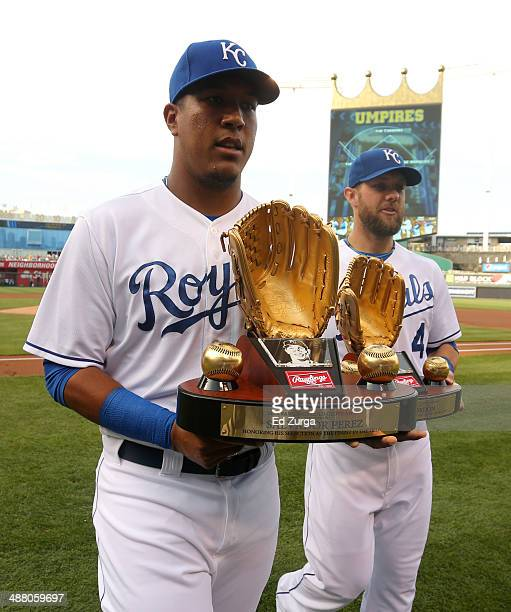 Salvador Perez and Alex Gordon of the Kansas City Royals hold their Golden Glove awards during a special presentation prior to a game against the...