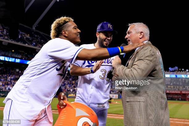Salvador Perez and Mike Moustakas of the Kansas City Royals celebrate defeating the Cleveland Indians 31 and they wish Joel Goldberg of Fox Sports a...