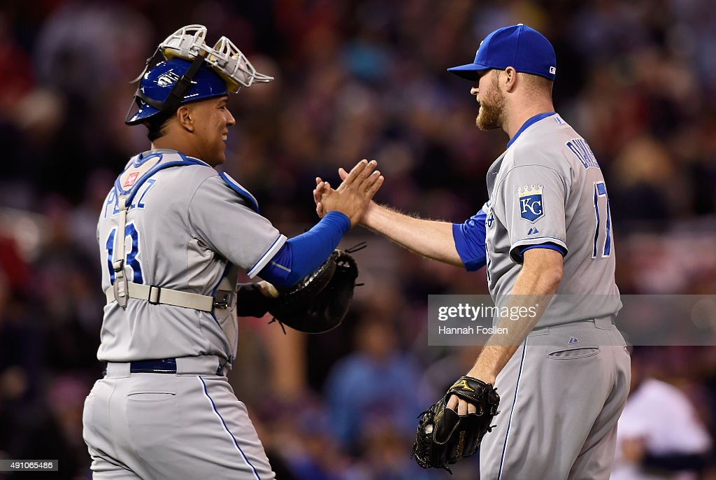 Salvador Perez #13 and Wade Davis #17 of the Kansas City Royals celebrate a win against the Minnesota Twins on October 2, 2015 at Target Field in Minneapolis, Minnesota. The Royals defeated the Twins 3-1.