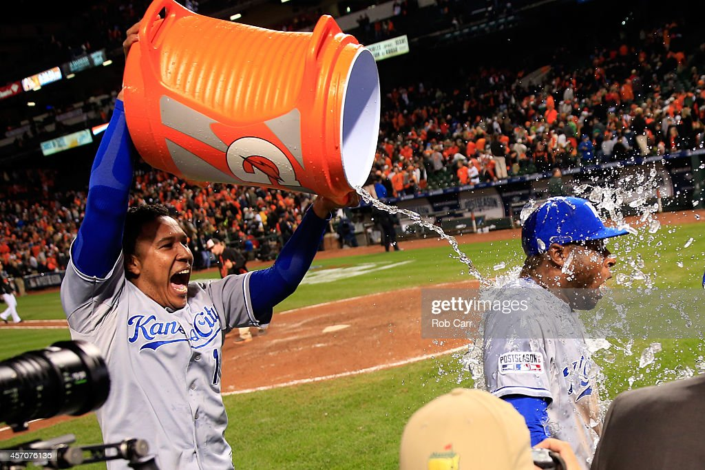 Salvador Perez #13 celebrates with teammate Lorenzo Cain #6 of the Kansas City Royals after defeating the Baltimore Orioles 6 to 4 in Game Two of the American League Championship Series at Oriole Park at Camden Yards on October 11, 2014 in Baltimore, Maryland.