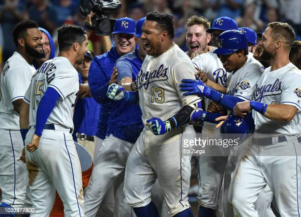 Salvador Perez celebrates with Whit Merrifield and members of the Kansas City Royals as he celebrates his walkoff grand slam against the Minnesota...