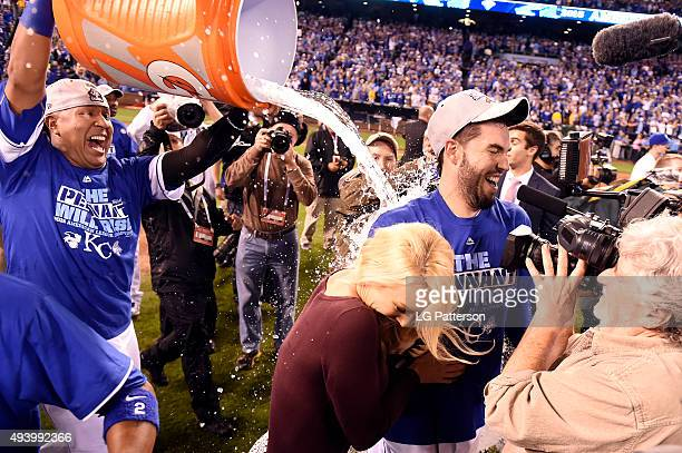 Salvador Perez dumps water on Eric Hosmer of the Kansas City Royals after winning Game 6 of the ALCS against the Toronto Blue Jays at Kauffman...