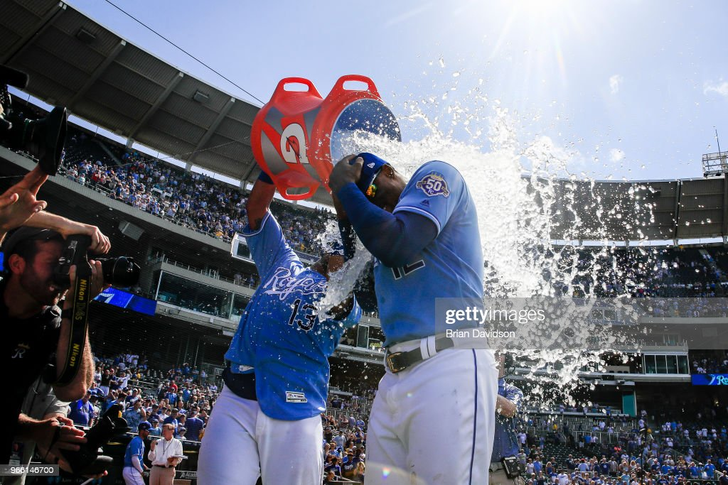 Salvador Perez #13 dumps water on Jorge Soler #12 of the Kansas City Royals after they defeated the Oakland Athletics at Kauffman Stadium on June 2, 2018 in Kansas City, Missouri.