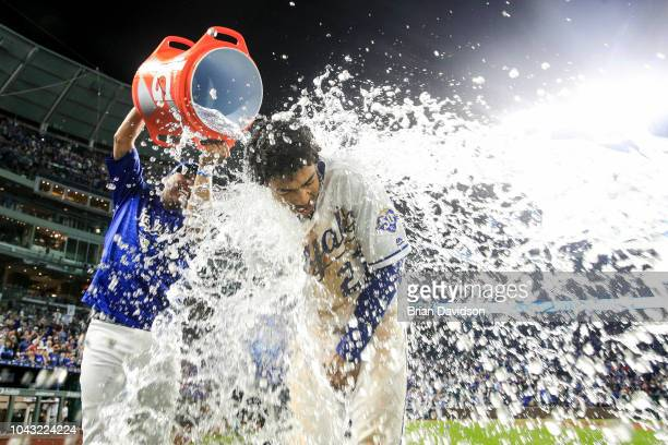 Salvador Perez dumps water onto Adalberto Mondesi of the Kansas City Royals after the Royals defeated the Cleveland Indians at Kauffman Stadium on...