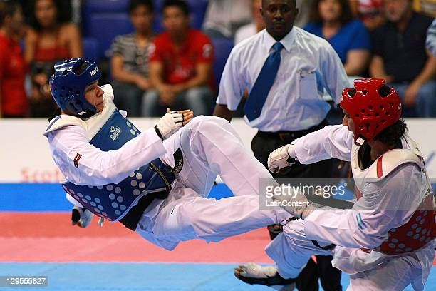 Salvador Perez , of Mexico, in action against Martin Sio, of Argentina, during men's heavy category of taekwondo competition as part of the Pan...