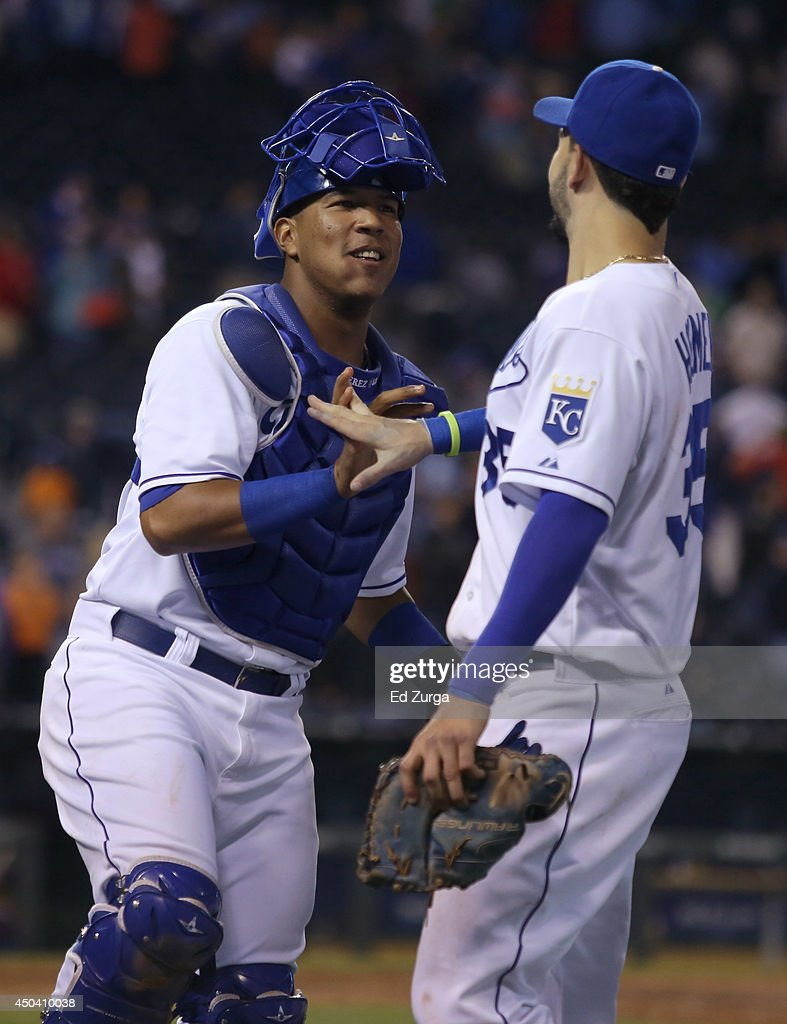 Salvador Perez #13 of the Kansas City Royals and Eric Hosmer celebrate a 9-5 win over the Cleveland Indians at Kauffman Stadium on June 10, 2014 in Kansas City, Missouri.