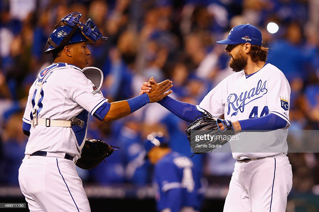 Salvador Perez #13 of the Kansas City Royals and Luke Hochevar #44 of the Kansas City Royals celebrate defeating the Toronto Blue Jays 5-0 in game one of the American League Championship Series at Kauffman Stadium on October 16, 2015 in Kansas City, Missouri.