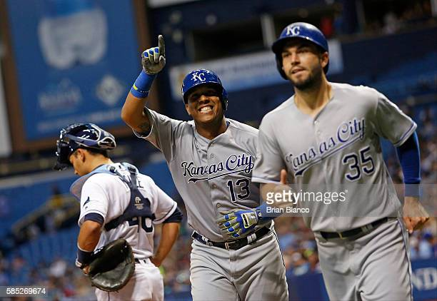 Salvador Perez of the Kansas City Royals and teammate Eric Hosmer celebrate behind catcher Luke Maile of the Tampa Bay Rays as they make their way to...