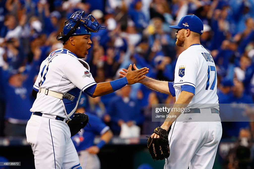 Salvador Perez #13 of the Kansas City Royals and Wade Davis #17 of the Kansas City Royals celebrate defeating the Toronto Blue Jays 6-3 in game two of the American League Championship Series at Kauffman Stadium on October 17, 2015 in Kansas City, Missouri.