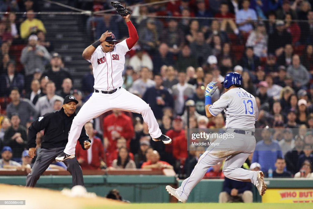 Salvador Perez #13 of the Kansas City Royals beats the tag from Rafael Devers #11 of the Boston Red Sox during the eighth inning at Fenway Park on May 1, 2018 in Boston, Massachusetts.