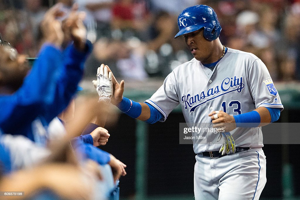 Salvador Perez #13 of the Kansas City Royals celebrates after scoring during the fifth inning against the Cleveland Indians at Progressive Field on September 20, 2016 in Cleveland, Ohio.