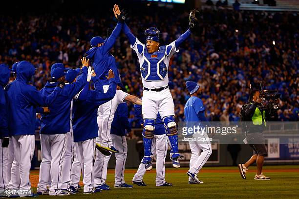 Salvador Perez of the Kansas City Royals celebrates defeating the New York Mets 7-1 in Game Two of the 2015 World Series at Kauffman Stadium on...