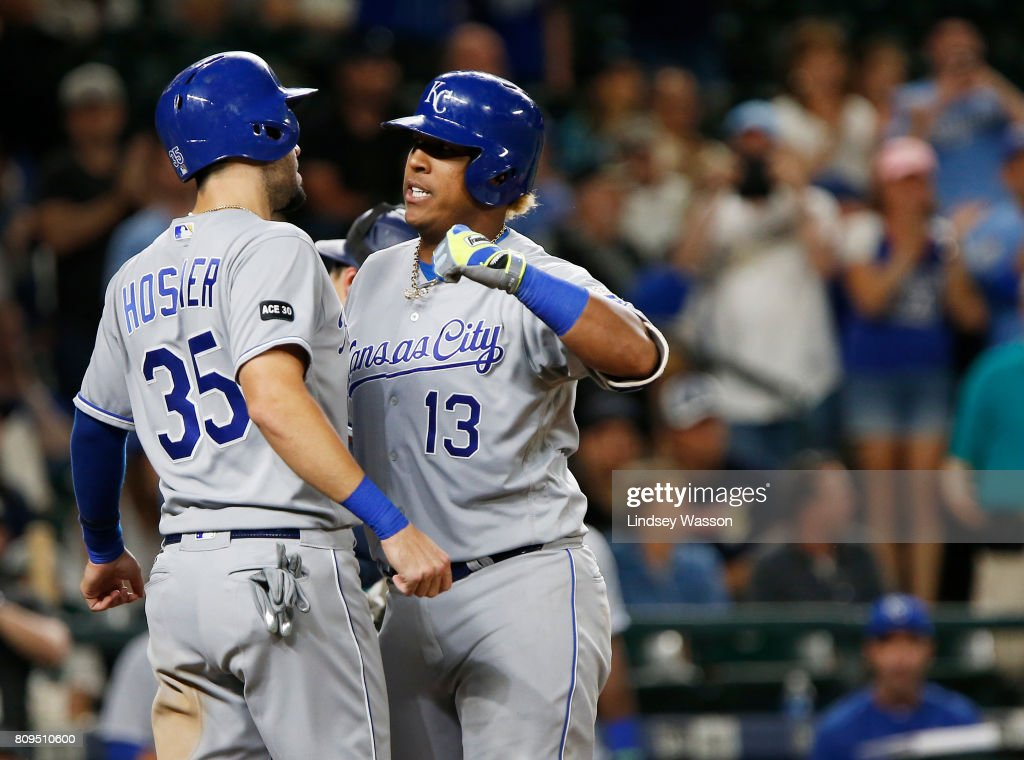 Salvador Perez #13 of the Kansas City Royals celebrates his two run home run with Eric Hosmer #35 in the top of the tenth inning to give the Royals the lead over the Mariners at Safeco Field on July 5, 2017 in Seattle, Washington.