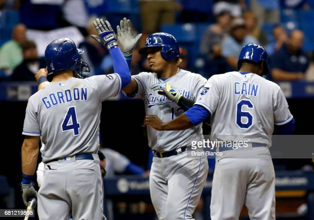 Salvador Perez of the Kansas City Royals celebrates his tworun home run with teammates Alex Gordon and Lorenzo Cain during the sixth inning of a game...