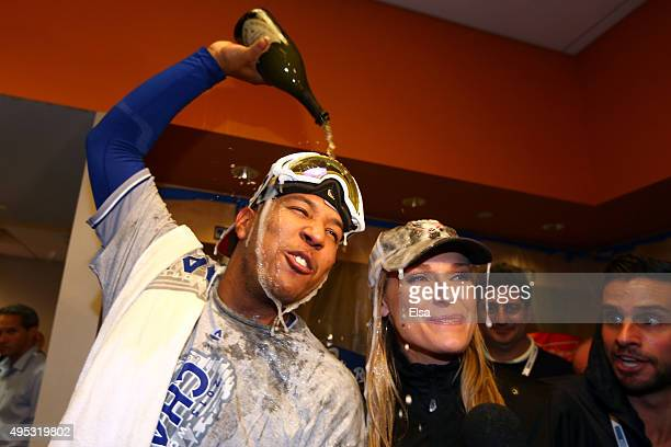 Salvador Perez of the Kansas City Royals celebrates in the clubhouse with MLB sportscaster Heidi Watney after defeating the New York Mets to win Game...