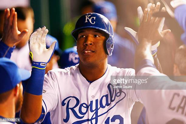 Salvador Perez of the Kansas City Royals celebrates in the dugout after hitting a solo home run in the fourth inning against the Toronto Blue Jays...