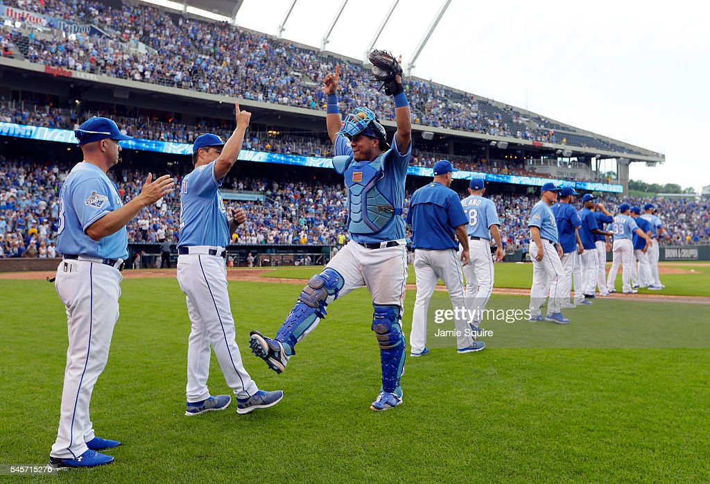 Salvador Perez #13 of the Kansas City Royals celebrates with coaches and teammates after the Royals defeated the Seattle Mariners 5-3 to win the game at Kauffman Stadium on July 9, 2016 in Kansas City, Missouri.