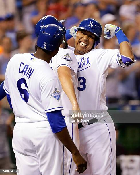 Salvador Perez of the Kansas City Royals celebrates with Eric Hosmer and Lorenzo Cain after hitting a home run during the 5th inning of the game...