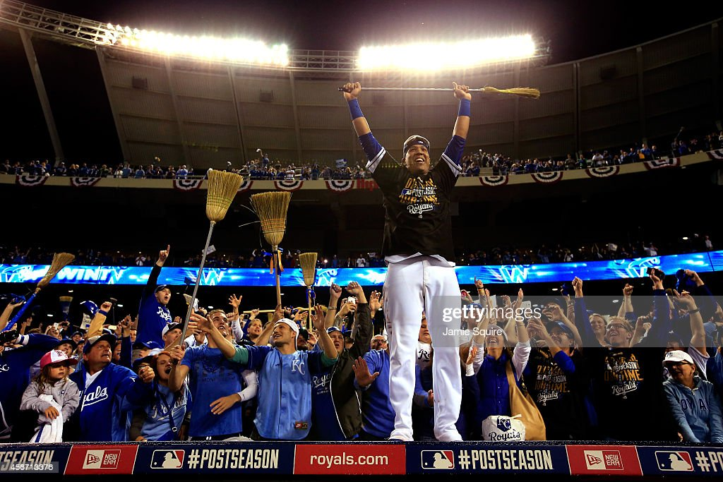 Salvador Perez #13 of the Kansas City Royals celebrates with fans on top of the dugout after the Royals defeated the Los Angeles Angels 9-3 to win game 3 of the American League Division Series at Kauffman Stadium on October 5, 2014 in Kansas City, Missouri.