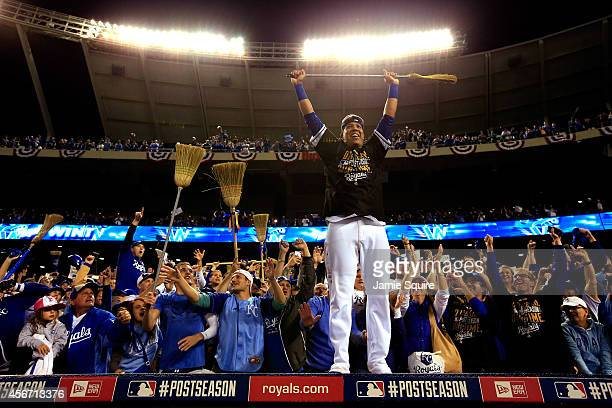 Salvador Perez of the Kansas City Royals celebrates with fans on top of the dugout after the Royals defeated the Los Angeles Angels 93 to win game 3...