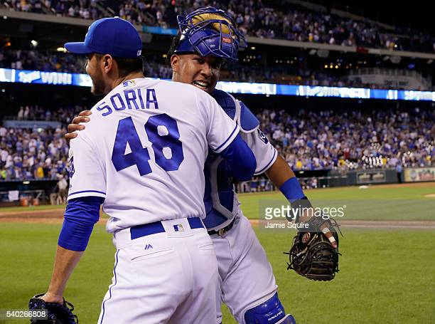 Salvador Perez of the Kansas City Royals celebrates with pitcher Joakim Soria after the Royals defeated the Cleveland Indians 32 to win the game at...