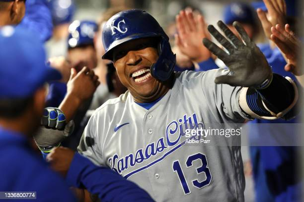 Salvador Perez of the Kansas City Royals celebrates with teammates in the dugout after hitting a grand slam to tie the game 5-5 against the Seattle...