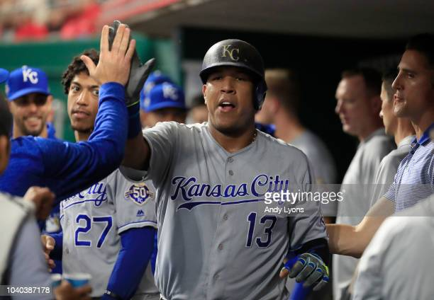 Salvador Perez of the Kansas City Royals celebrates with teammates after scoring in the second inning against the Cincinnati Reds at Great American...