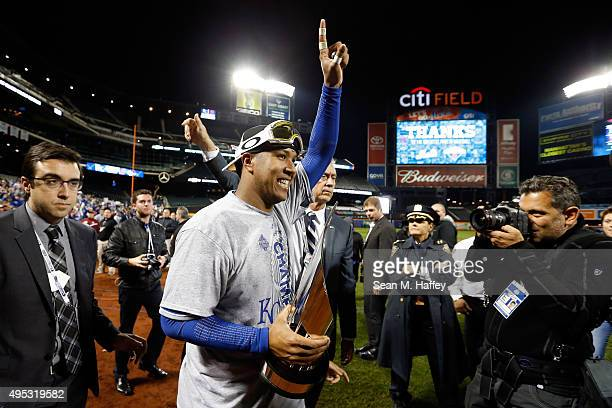 Salvador Perez of the Kansas City Royals celebrates with the World Series Most Valuable Player Award after defeating the New York Mets to win Game...