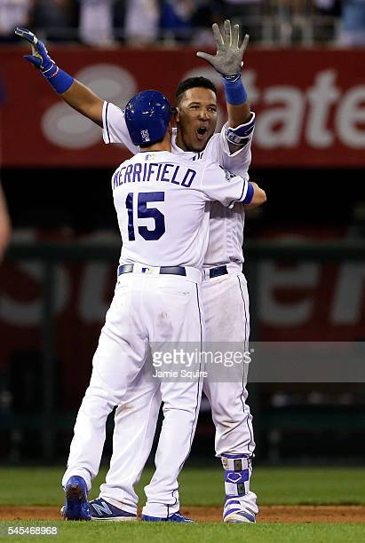 Salvador Perez of the Kansas City Royals celebrates with Whit Merrifield in the 9th inning after hitting a gamewinning double to knock in two runs as...
