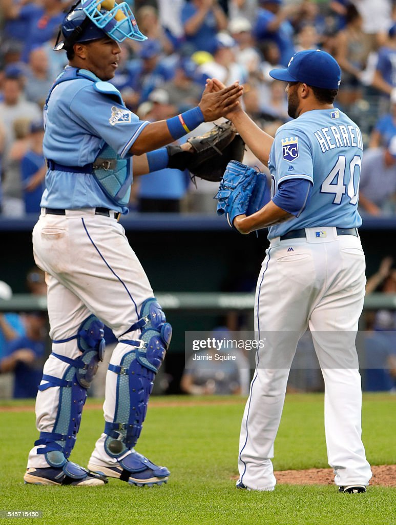 Salvador Perez #13 of the Kansas City Royals congratulates Kelvin Herrera #40 after the Royals defeated the Seattle Mariners 5-3 to win the game at Kauffman Stadium on July 9, 2016 in Kansas City, Missouri.