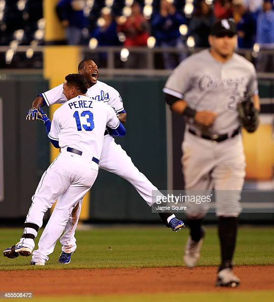 Salvador Perez of the Kansas City Royals congratulates Lorenzo Cain after Cain hit the gamewinning single to drive in Terrance Gore as Avisail Garcia...