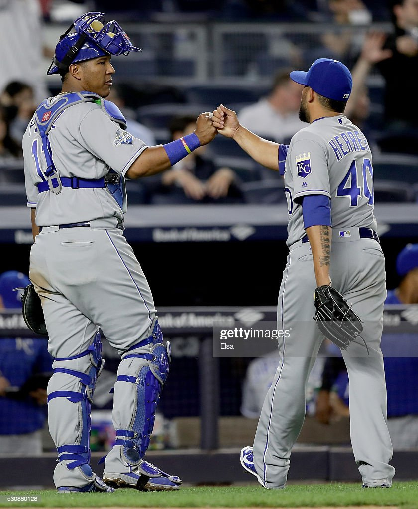 Salvador Perez #13 of the Kansas City Royals congratulates teammate Kelvin Herrera #40 of the Kansas City Royals after the 8th inning against the New York Yankees at Yankee Stadium on May 11, 2016 in the Bronx borough of New York City.