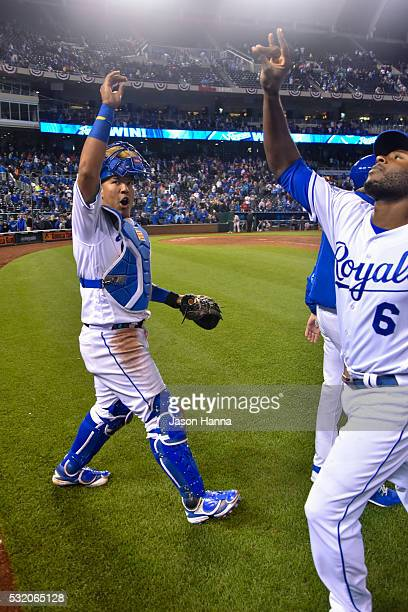 Salvador Perez of the Kansas City Royals does his special handshake with teammate Lorenzo Cain after the game in which the Royals defeated the Boston...